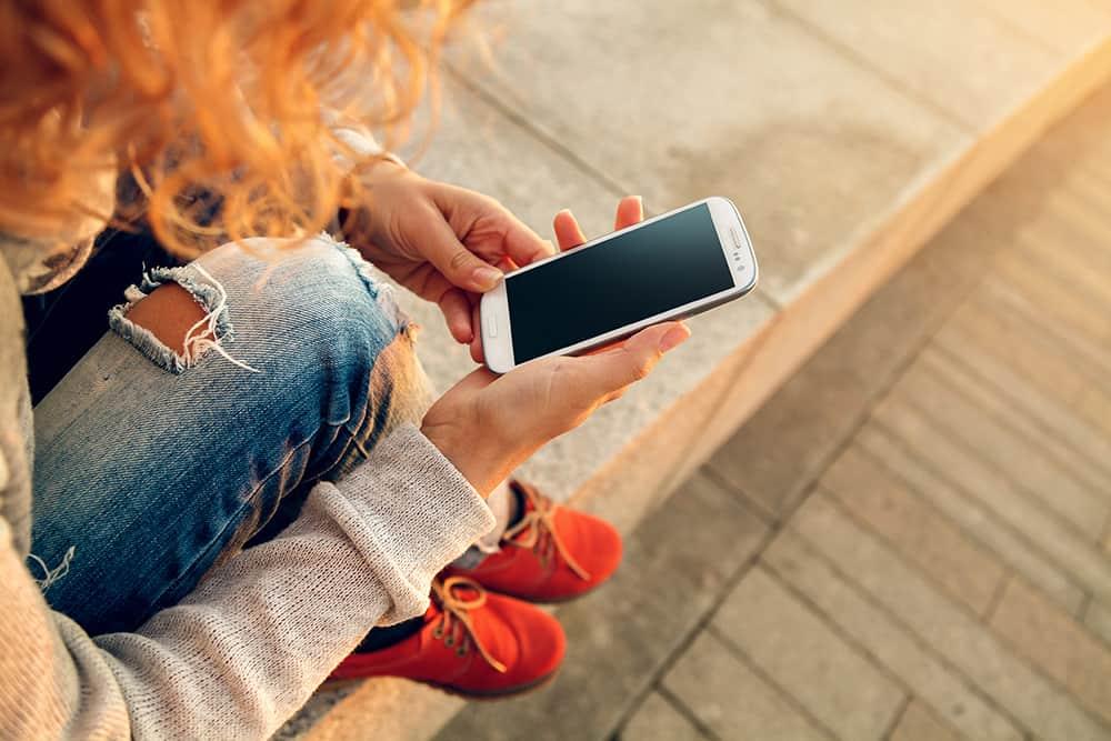 Redhead woman using smart phone